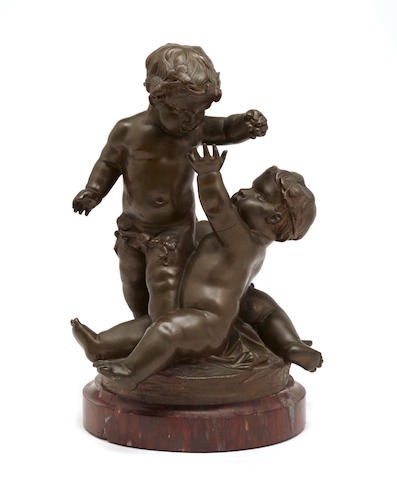 A French patinated bronze figural group of three Bacchic putti