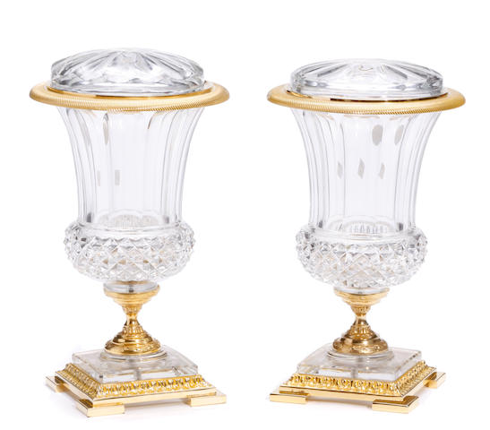 A pair of gilt metal mounted and cut glass covered vases of campana form