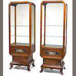 A pair of French Chinoiserie decorated mother-of-pearl inlaid hardwood vitrine cabinets<BR />late 19th/early 20th century