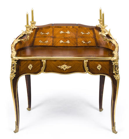 A Louis XV style gilt bronze mounted kingwood bureau en rognon<BR />Maison Millet<BR />late 19th/early 20th century