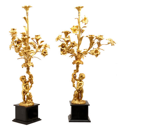 A pair of French gilt bronze five light candelabra