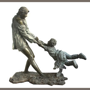 A patinated metal life-size group of a young woman playing with a child