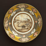 A Rockefeller patterned porcelain saucer dish with grisaille and gilt decoration, landscape center monogrammed JJ, 19th century