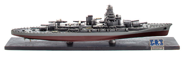 A rare Imperial Japanese Navy identification model of the battleship Nagato  before 1941 19-1/2 x 2-3/4 x 5 in. (49.5 x 6.9 x 12.7 cm.) model on base.