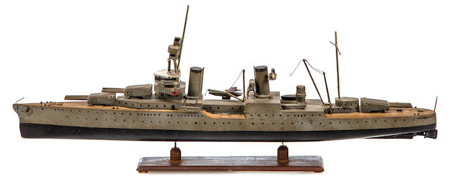 A sailor-made model of the U.S.S. Indianapolis  before July 1945 12-1/2 x 5 in. (31.7 x 12.7 cm.) length x height on stand.