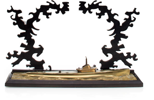 A commemorative World War II fleet submarine waterline model with Tsunami wave trees  after 1942 9-1/2 x 15-1/2 in. (24.1 x 39.3 cm.) height x length. 2