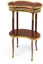 A Louis XVI style gilt bronze mounted mahogany parquetry table en rognon<BR />circa 1900