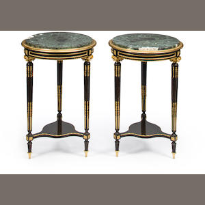 A pair of Louis XVI style gilt bronze mounted rosewood and ebonized guéridons. circa 1900