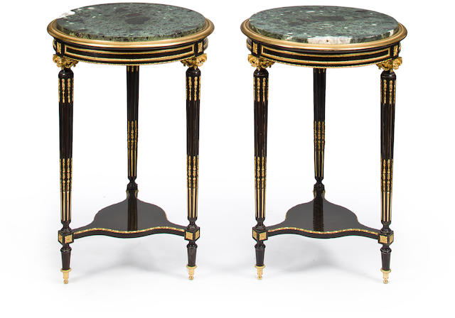 A pair of Louis XVI style gilt bronze mounted rosewood and ebonized guéridons<BR />circa 1900