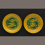 A pair yellow ground glazed and dragon decorated porcelain saucers (one with chip)