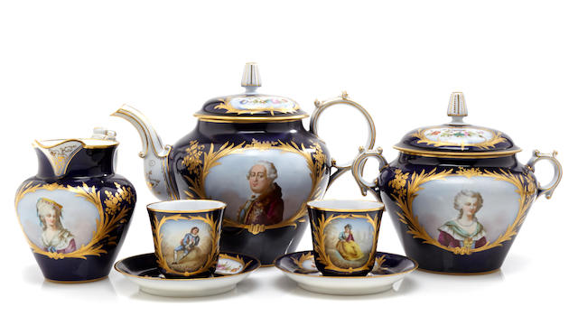 A Sèvres style cobalt ground porcelain part tea service