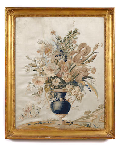 A French silk embroidered urn with flowers, framed
