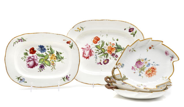 A set of three porcelain floral decorated leaf dishes together with two Continental graduated porcelain platters