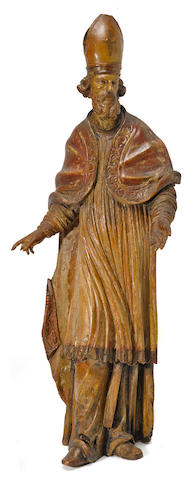 A Spanish Baroque polychrome and gilt decorated carved wood figure of a bishop  17th century