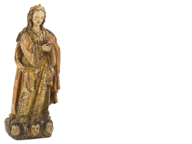 A Spanish Baroque polychrome and gilt decorated carved wood figure of the Virgin 17th century