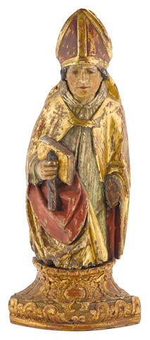 A German Baroque polychrome and gilt decorated carved wood figure of a Bishop 16th century