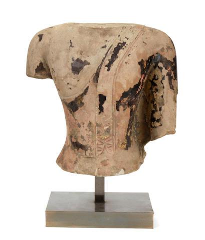 A sandstone Buddha torso with lacquer