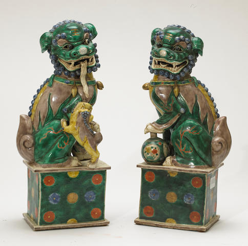 A pair of polychrome enameled porcelain lion dogs on stands China, contemporary