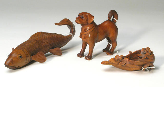 A group of three Japanese wood animal carvings