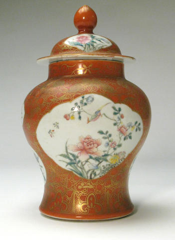 A coral red ground porcelain covered jar with famille rose enamel decoration 20th century