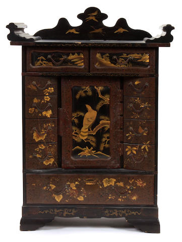 A Japanese lacquer cabinet with gilt decoration