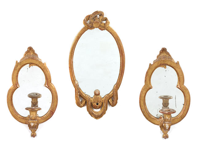 A Louis XVI style giltwood oval mirror