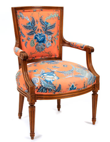 A Louis XVI style mixed wood fauteuil