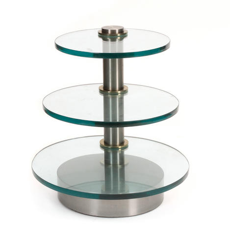A Contemporary brushed stainless steel and glass three tier side table