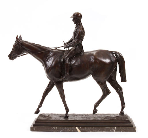 A patinated bronze figure of a jockey and horse