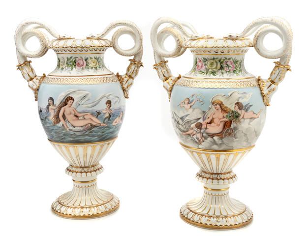 A pair of Meissen outside decorated porcelain snake handled vases