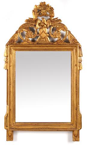 An Italian Neoclassical giltwood wall mirror