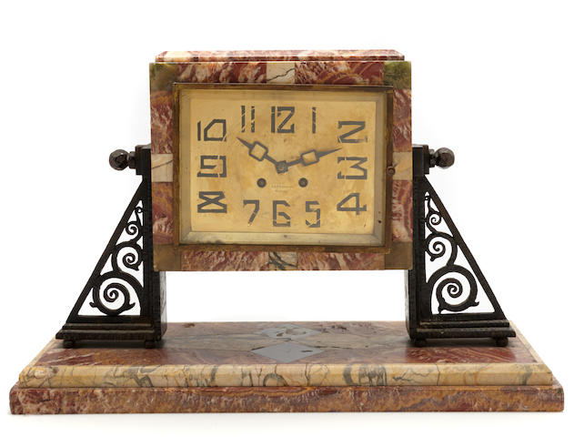 An Art Deco marble and wrought-iron clock  circa 1930