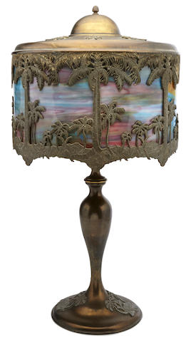 An American glass and patinated metal Tropical Sunset lamp early 20th century