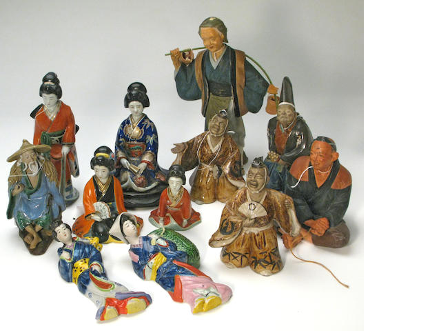 A large group of Japanese ceramic figures