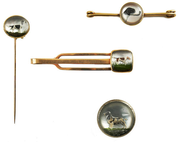 Group of four early 20th century reverse carved and painted intaglio Gun Dog jewelry pieces (4)