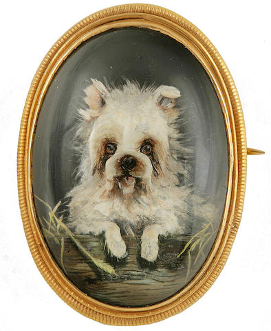 A late 19th/early 20th century reverse carved and painted intaglio Terrier pin