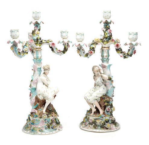A pair of German Rococo style porcelain candelabra