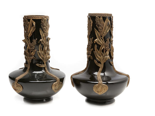 A pair of bronze mounted ceramic vases