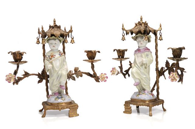 A pair of Chinese Chippendale style gilt bronze and porcelain figural candelabra