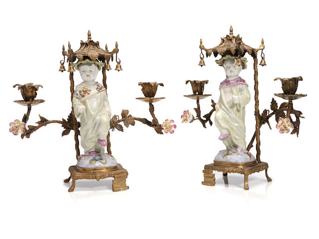 A pair of Chinese Chippendale style gilt bronze and porcelain candelabra