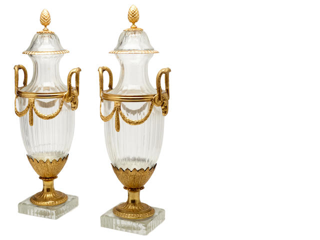 A pair of gilt bronze mounted glass urns