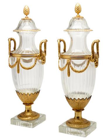 A pair of gilt bronze mounted glass urns