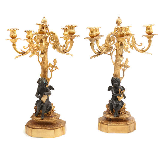A Louis XV style gilt and patinated bronze figural candelabra