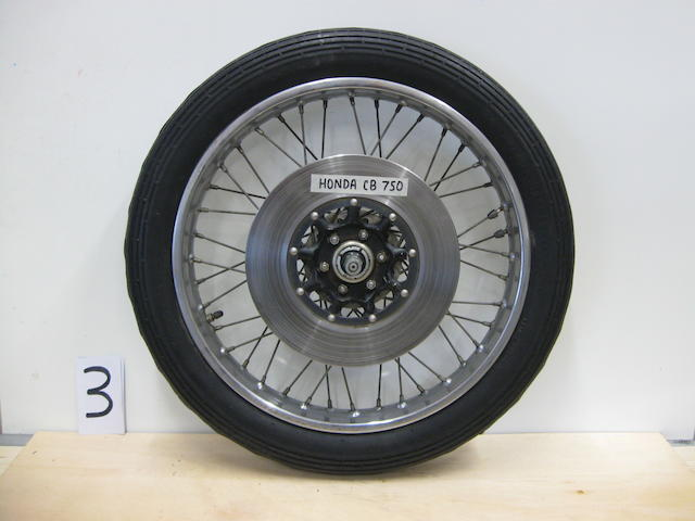 A set of front and rear 70s era Honda CB750 wheels,
