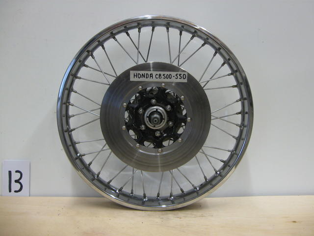 A set of front and rear 70s era Honda CB500-550 wheels,