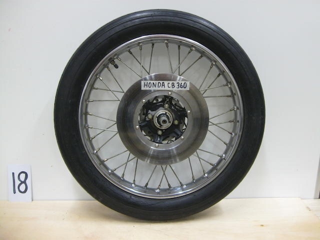A set of front and rear 70s era Honda CB360 wheels,