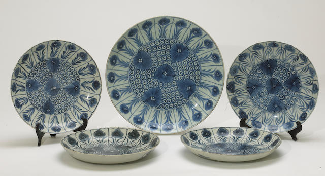 A group of five blue and white export porcelains with Chinese Aster decoration Kangxi period