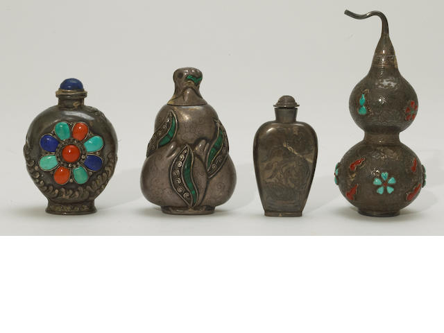 A group of four silver snuff bottles