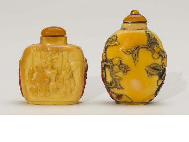 A group of two carved hornbill snuff bottles
