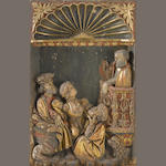 A Spanish polychrome and gilt decorated carved wood relief panel 16th century
